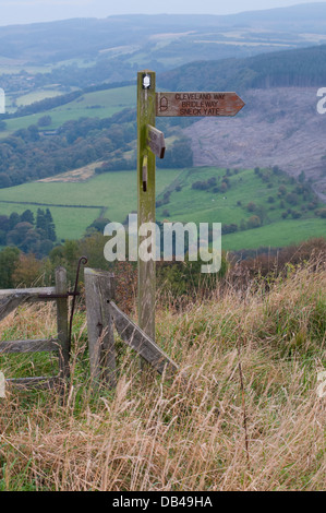 Wooden fingerpost marking Cleveland Way National Trail in beautiful hilltop location with scenic panorama beyond - Stock Photo