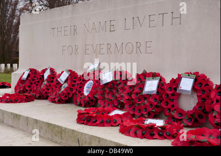 Circular red poppy wreaths on Stone of Remembrance after ceremony & inscription close-up - Stonefall Cemetery, Harrogate, - Stock Photo