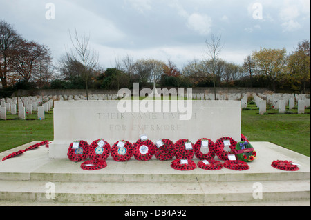 Rows of war graves & red poppy wreaths laid on Stone of Rememberance after ceremony - Stonefall Cemetery, Harrogate, - Stock Photo