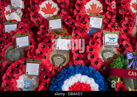 Close-up of poppy wreaths laid on memorial on Remembrance Day to commemorate war dead - Stonefall Cemetery, Harrogate, - Stock Photo