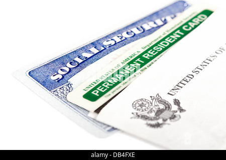 United States of America social security and green card on white background. Immigration concept. - Stock Photo