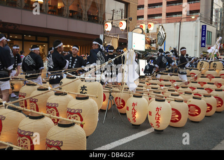 Participants of the Akita Kanto Festival with the lanterns waiting for the festival to begin - Stock Photo