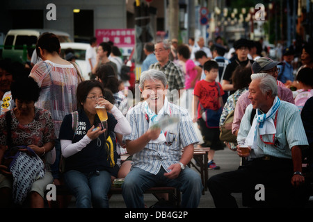 Old Japanese people waiting for the Akita Kanto Festival to start - Stock Photo