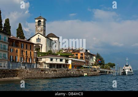 Lakefront of Brissago with the Parish Church of Saints Peter and Paul, Lago Maggiore, Ticino, Switzerland - Stock Photo