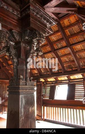 Carving on wooden pillar of single Jackfruit wood, Padmanabhapuram Palace, kerala India - Stock Photo