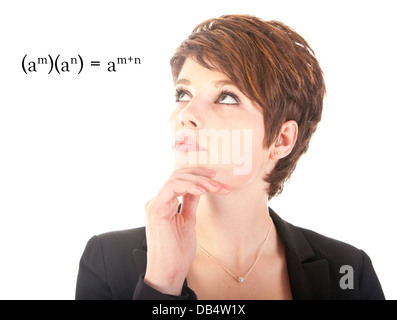 Young woman looking at mathematics isolated on white background - Stock Photo