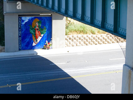 Surfing Virgin Mary A street art instillation in Encinitas, California is causing waves among locals. A massive - Stock Photo