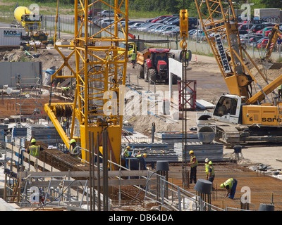 Large building project, the new train station of Breda, the Netherlands, with lots of people working. - Stock Photo