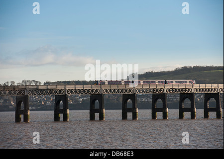 First Scotrail train crossing the Tay Rail Bridge spanning the Firth of Tay, Scotland. - Stock Photo