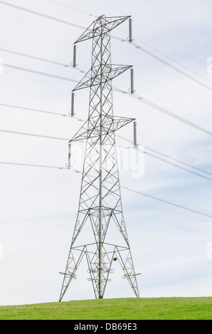 Transmission tower with overhead power lines, England - Stock Photo