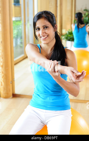 young, pretty, sportive woman, stretching (model-released) - Stock Photo