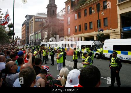 A smoke bomb is thrown at police during the English Defence League protest on Birmingham's Broad St on July 20th, - Stock Photo