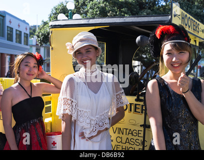 dh Art Deco weekend NAPIER NEW ZEALAND Asian girls dressed 1930s fashion clothes holiday festival women tourists - Stock Photo
