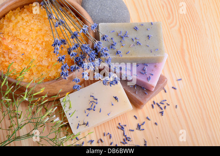 Natural soaps with bath salt on wooden background - Stock Photo