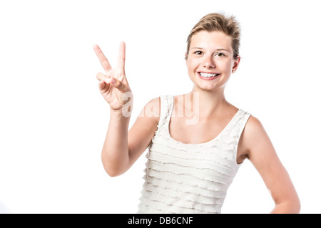 Laughing, young beautiful woman makes the victory sign, isolated on white background - Stock Photo