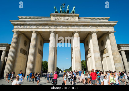 Many tourists at Brandenburg Gate in Berlin Germany - Stock Photo