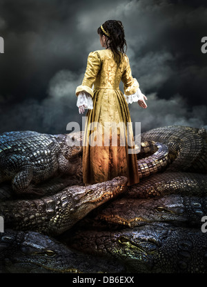 Medieval young girl surrounded by crocodiles - Stock Photo