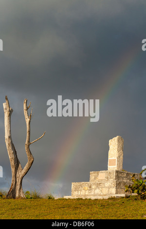 Lost at Sea Monument with Rainbow and dead tree. This monument is dedicated to the souls lost at sea off the Elbow - Stock Photo