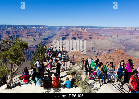 Crowd of tourists at Mather Point Lookout, South Rim, Grand Canyon National Park, Arizona, USA - Stock Photo