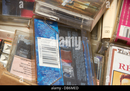 Collection of old tape cassettes in a charity shop - Stock Photo