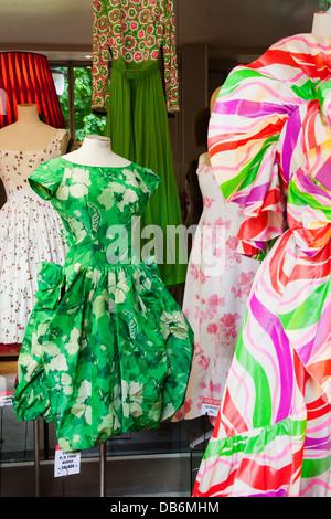 Colorful window display of vintage dresses at world-famous designer Didier Ludot's boutique at Palais Royal, Paris - Stock Photo