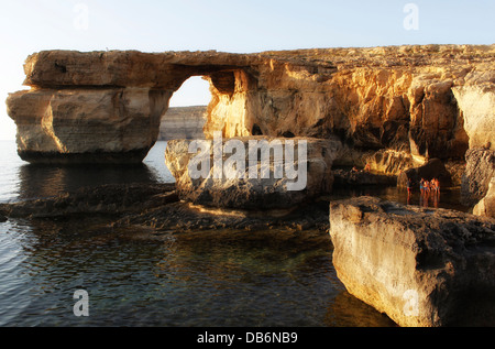 View of the natural arch high rock formation Azure window in Dwejra bay in the island of Gozo, the sister island - Stock Photo