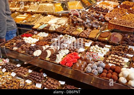 chocolates on display inside the la boqueria market in Barcelona Catalonia Spain - Stock Photo