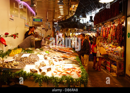 fresh seafood and shellfish on display inside the la boqueria market in Barcelona Catalonia Spain - Stock Photo