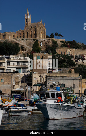 View of Our Lady of Lourdes Chapel on a promontory overlooking Mgarr Harbour. Gozo island the sister island of Malta - Stock Photo