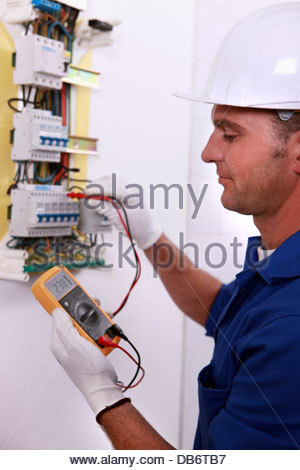 an old electric fuse box switchboard ceramic fuses stock electrician inspecting fuse box stock photo