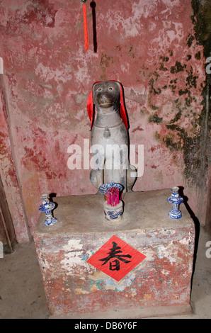 Vietnam, Da Nang. Historic village of Hoi An. Japanese Covered Bridge, c. 1593, shrine with dog. A UNESCO World - Stock Photo