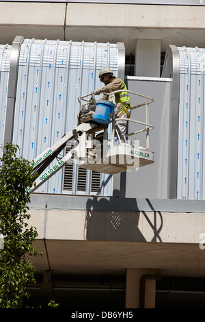 worker on elevated working platform Barcelona Catalonia Spain - Stock Photo
