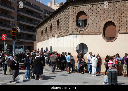 tourists and visitors in long queue to enter the Sagrada Familia Barcelona Catalonia Spain - Stock Photo