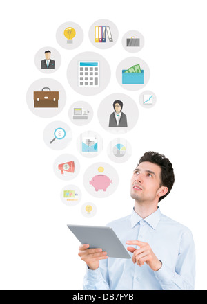 Young man holding digital tablet computer and looking on collection of mobile application icons on business and - Stock Photo
