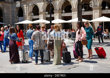 group of well dressed women visitors in Placa Reial gothic quarter Barcelona Catalonia Spain - Stock Photo