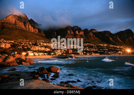sunset at Maidens Cove and camps Bay with Table Mountain and the Twelve Apostles in the background, Cape Town, South - Stock Photo