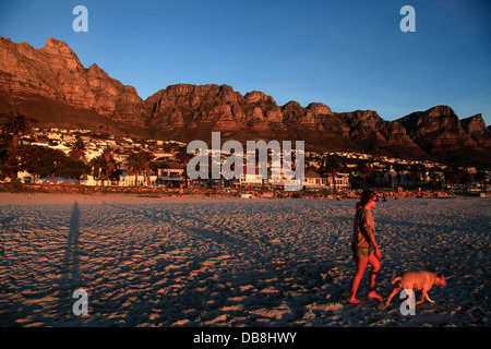 sunset at Camps Bay beach in Cape Town - Stock Photo