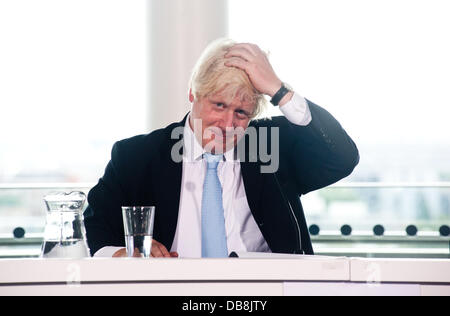London, UK - 25 July 2013: Mayor of London, Boris Johnson touches his hair during the press conference to examine - Stock Photo