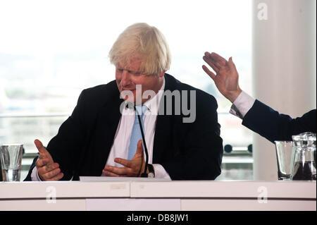 London, UK - 25 July 2013: Minister for Sport and Tourism, Rt Hon Hugh Robertson (R) pats Mayor of London, Boris - Stock Photo