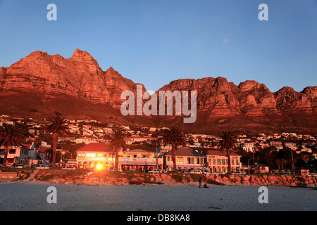 Summer time and sunset on Camps Bay Beach in Cape Town - Stock Photo