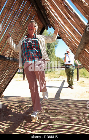 tourist standing on an ostrich egg at Safari Ostrich Farm in Oudtshoorn, Little Karoo - Stock Photo