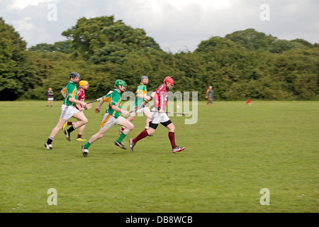Men playing Gaelic sports (hurling) being played in England at the Tir Chonaill Gaels club in Greenford, Middlesex, - Stock Photo