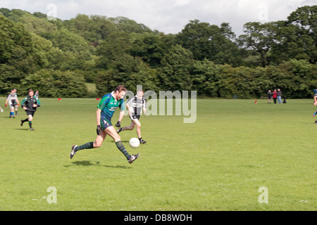 Men playing Gaelic sports (Gaelic football) being played in England at the Tir Chonaill Gaels club in Greenford, - Stock Photo