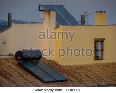 Marbella Spain Hot Water Solar Panels Heating on Roof - Stock Photo