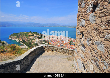 High aspect view and panorama of the old part of the seaport city of Nafplio and of Bourtzi Castle from Palamidi - Stock Photo
