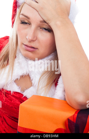 Tired stressed Christmas woman in Santa costume. - Stock Photo