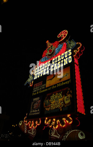 Black sky night portrait red blue neon electric marquee sign 'Lucky the Clown', Circus Circus Casino, Las Vegas - Stock Photo