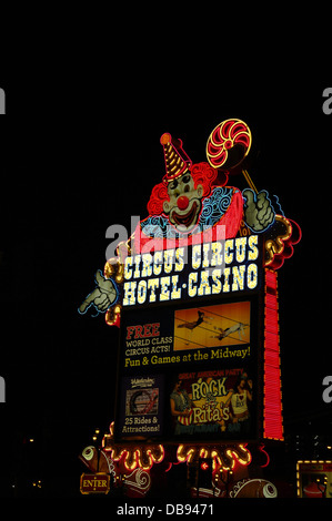 Black sky night neon red blue colours smiling face electric sign marque 'Lucky the Clown', Circus Circus Casino, - Stock Photo