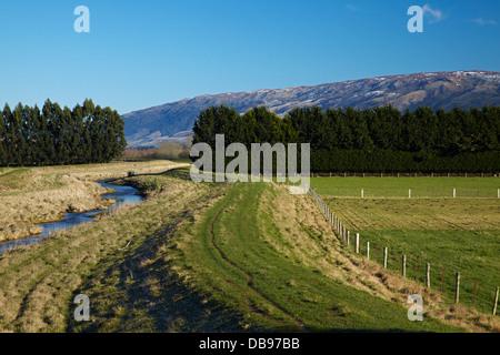 Silver Stream and flood banks, Taieri Plains, near Dunedin, South Island, New Zealand - Stock Photo