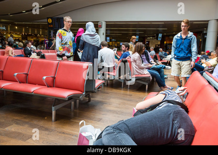 Waiting for a flight at Heathrow Airport, London, UK. - Stock Photo